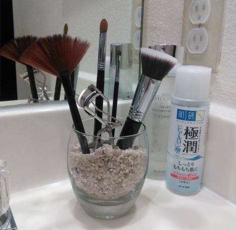 Makeup brushes and Shu Uemura eyelash curler.