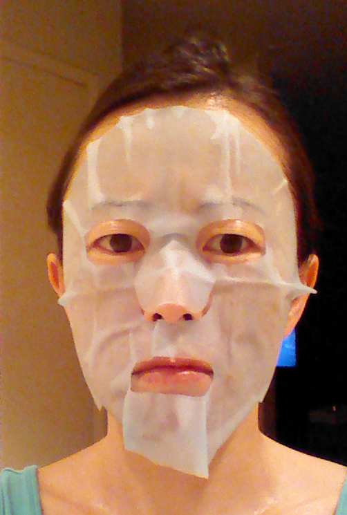 Sheet mask with two backing sides