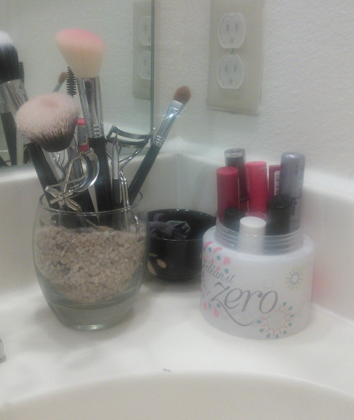 Second bathroom counter makeup and hair accessories