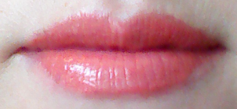 Lip swatch of Memebox Pony Blossom lipstick in Orange Dahlia